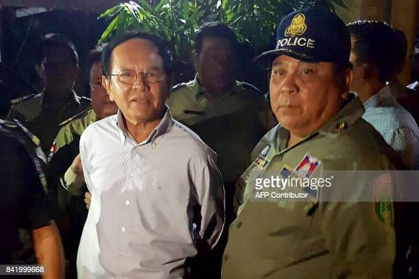 Cambodian opposition leader Kem Sokha is escorted by police at his home in Phnom Penh on September 3 2017 Cambodian opposition leader Kem Sokha was...