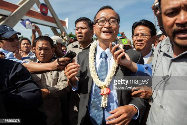 Cambodian opposition leader Sam Rainsy returned to Cambodia to be greeted by supporters Sam Rainsy led a parade of supporters through the streets of...