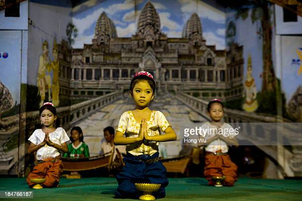Cambodian orphans perform their daily traditional dancing performance for foreign visitors raising donations in a nongovernment orphanage on...