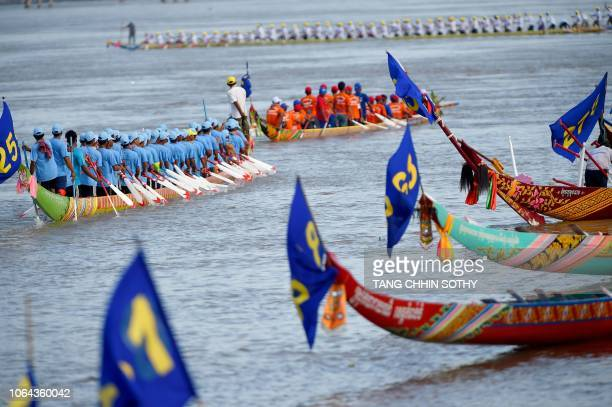 Cambodian participants row their dragon boats during a rehearsal for the annual Water Festival on the Tonle Sap river in Phnom Penh on November 23...