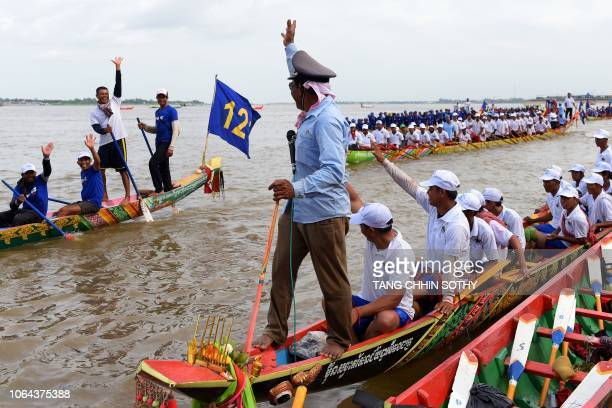Cambodian participants row their dragon boats on the Tonle Sap river during the annual Water Festival in Phnom Penh on November 23 2018