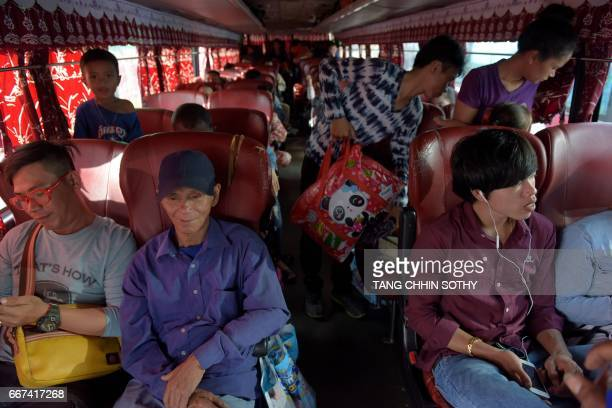Cambodian people take a bus from the capital Phnom Penh to their homeland in provinces on April 12, 2017 to celebrate the country's New Year festival...