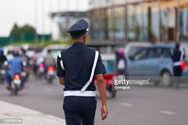 cambodian policeman - gwengoat stock pictures, royalty-free photos & images