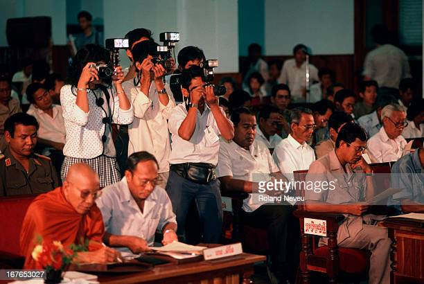 Cambodian President Heng Samrin and Prime Minister Hun Sen sitting on the front row at an opening session of a Parliament in Phnom Penh, while a...