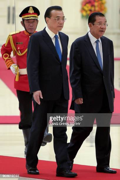 Cambodian Prime Minister Hun Sen and Chinese Premier Li Keqiang walk together at the Peace Palace in Phnom Penh on January 11 2018 Li Keqiang is on a...