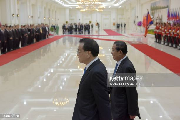 Cambodian Prime Minister Hun Sen and Chinese Premier Li Keqiang walk at the Peace Palace in Phnom Penh on January 11 2018 Li Keqiang is on a oneday...
