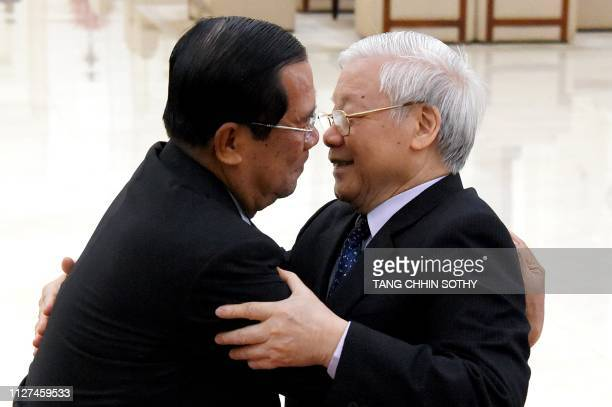 Cambodian Prime Minister Hun Sen hugs Vietnamese President Nguyen Phu Trong on arrival at the Peace Palace in Phnom Penh on February 26 2019...