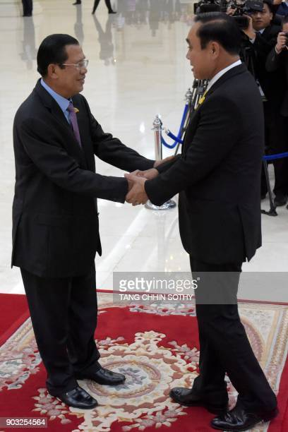 Cambodian Prime Minister Hun Sen shakes hands with Thai Prime Minister Prayuth ChanOCha during the second MekongLancang Cooperation Leaders' Meeting...
