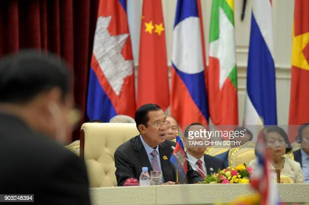 Cambodian Prime Minister Hun Sen speaks as Thai Prime Minister Prayuth ChanOCha listens during the second MekongLancang Cooperation Leaders' Meeting...