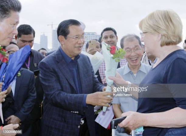 Cambodian Prime Minister Hun Sen welcomes passengers who disembarked from the Westerdam cruise ship at the port of Sihanoukville in southern Cambodia...