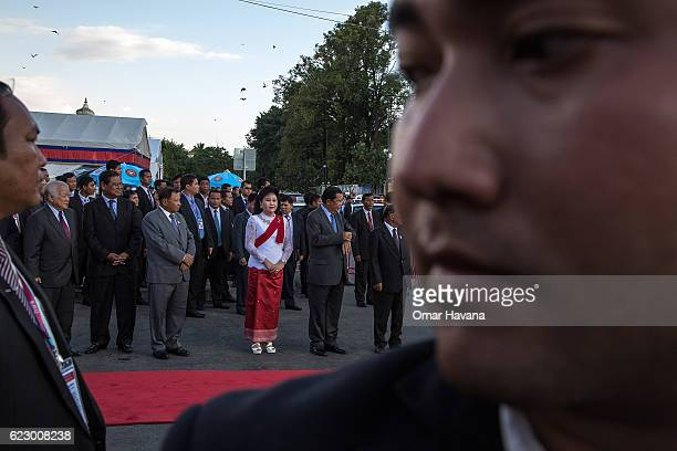 Cambodian Prime Minister Samdech Hun Sen First Lady Bun Rany and authorities stand waiting for the arrival of The King of Cambodia Norodom Sihamoni...