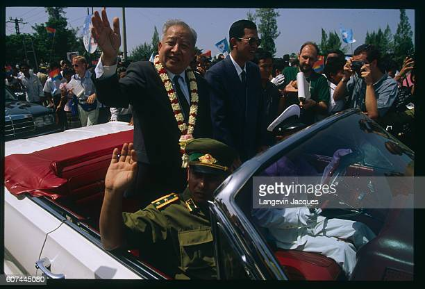 Cambodian Prince Sihanuk and his wife, Princess Monique, have just landed at the Phnom Penh airport. They leave the airport in a car that drives...