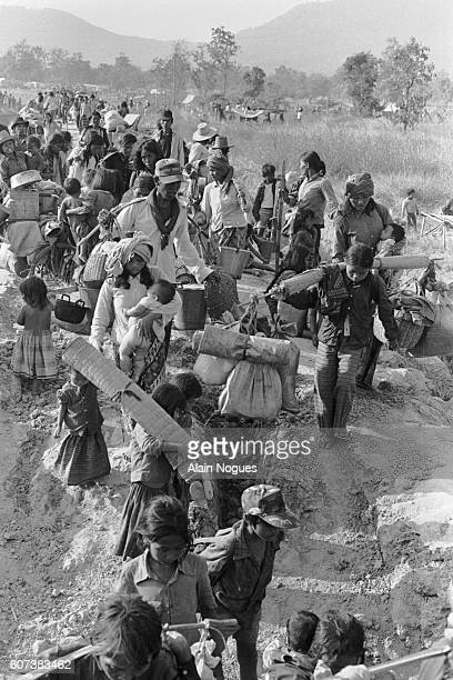 Cambodian refugees flee Ampil, where the Vietnamese are about to attack the Khmer People's National Liberation Front base camp. They make their way...