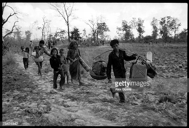 Cambodian refugees flee to the safety of Thailand, as fighting between the Vietnamese army and Khmer resistance forces rages closer to the Thai...