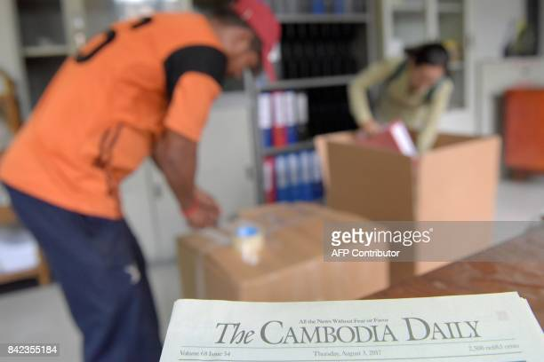 Cambodian reporters of the Englishlaguage newspaper Cambodia Daily pack documents at their office in Phnom Penh on September 4 2017 One of Cambodia's...