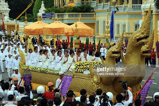 Cambodian Royal family members sit on a car shaped like a dragons during a procession of the remains of the late former king Norodom Sihanouk in...
