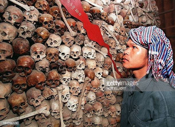 Cambodian Sam Vishna 28 years looks at a mixture of brown and white skulls that make up a map of Cambodia at Tuol Sleng Museum in Phnom Penh 9...