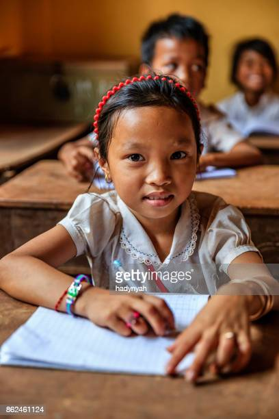 cambodian school children during class, tonle sap, cambodia - cambodian culture stock photos and pictures