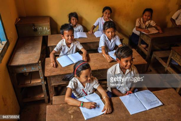 cambodian school children during class, tonle sap, cambodia - traditionally cambodian stock pictures, royalty-free photos & images