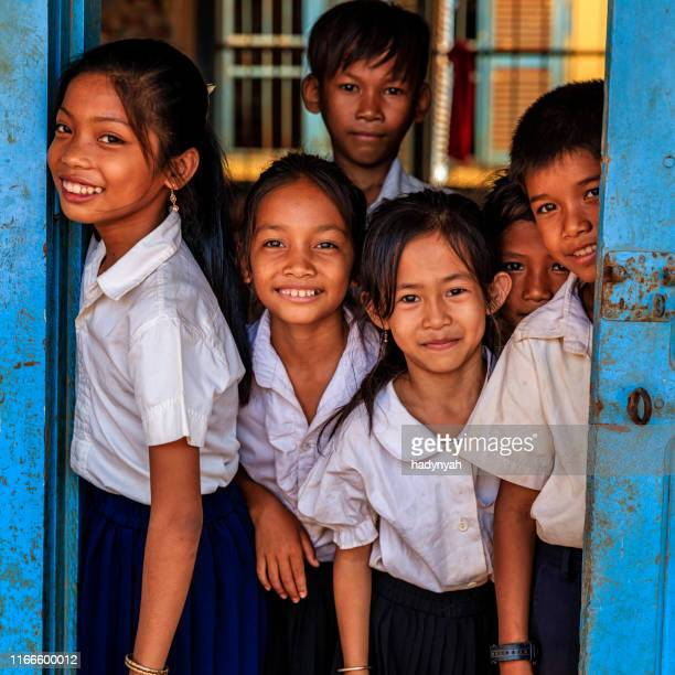 cambodian school children standing in doorway of classroom, cambodia - cambodia stock pictures, royalty-free photos & images
