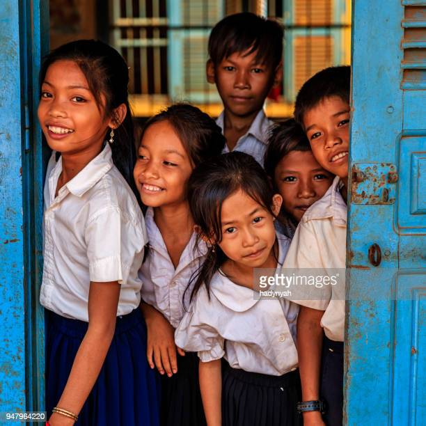 cambodian school children standing in doorway of classroom, cambodia - traditionally cambodian stock pictures, royalty-free photos & images