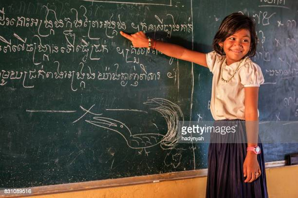 cambodian schoolgirl during class, tonle sap, cambodia - cambodia stock pictures, royalty-free photos & images