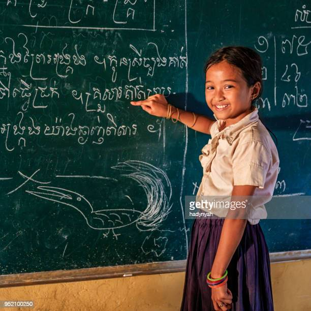 cambodian schoolgirl during class, tonle sap, cambodia - traditionally cambodian stock pictures, royalty-free photos & images