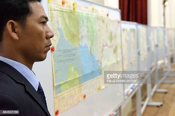 A Cambodian security guard stands next to Cambodia maps during a ceremony with Mereani Keleti Vakasisikakala acting President of the United Nations...