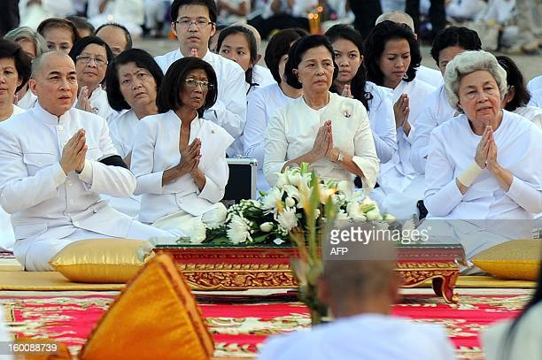 Cambodian Sihanouk's widow Queen Monique and King Norodom Sihamoni pray during a prayer ceremony in front of the Royal Palace in Phnom Penh on...