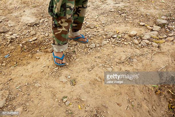 cambodian soldier fighting in flip-flops, preah vihear temple, cambodia - jake warga stock pictures, royalty-free photos & images