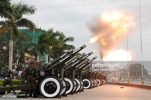 Cambodian soldiers fire cannons during a 101 gun salute in front of the Royal Palace in Phnom Penh on July 12 2014 on the final day of the ceremony...