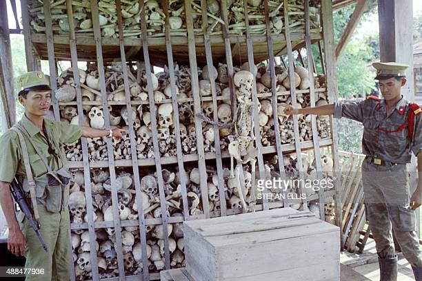 Cambodian soldiers point to skeletons of about 3 000 victims of the genocide perpetrated by the Khmer Rouge during their 197578 reign in Cambodia on...