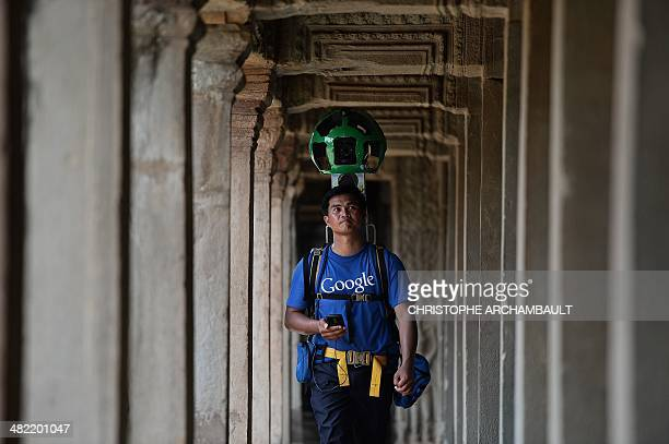 A Cambodian technician carries a backpack mounted with a device housing 15 cameras as he demonstrates the technique used to digitally map the Angkor...