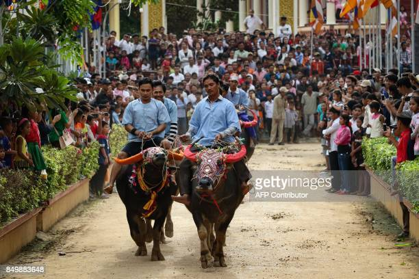Cambodian villagers ride buffaloes through the street during the Pchum Ben festival the festival of death at Vihear Suor village in Kandal province...