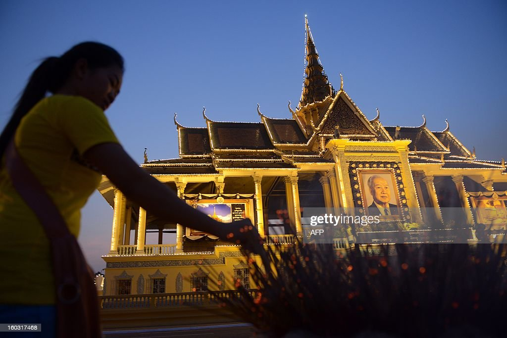 A Cambodian woman prays for the late former King Norodom Sihanouk in front of the Royal Palace in Phnom Penh on January 29, 2013. Cambodia will on January 30 brace for an elaborate funeral for revered former King Norodom Sihanouk, who died aged 89 and will be cremated on February 4.