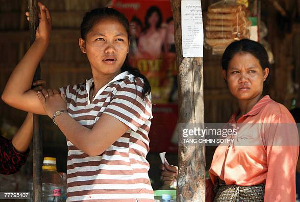 Cambodian women are pictured in a rural shop in the province of Svay Rieng, some 122 kilometers southeast of Phnom Penh, 06 November 2007. The gap...