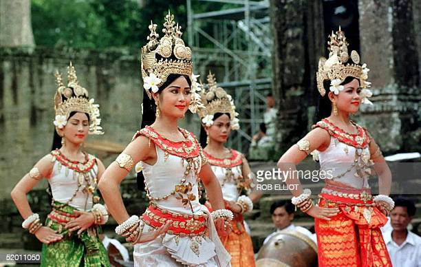 Cambodian women perform traditional Apsara dancing at a completion ceremony for the restoration of the northern library of Bayon at the Angkor...