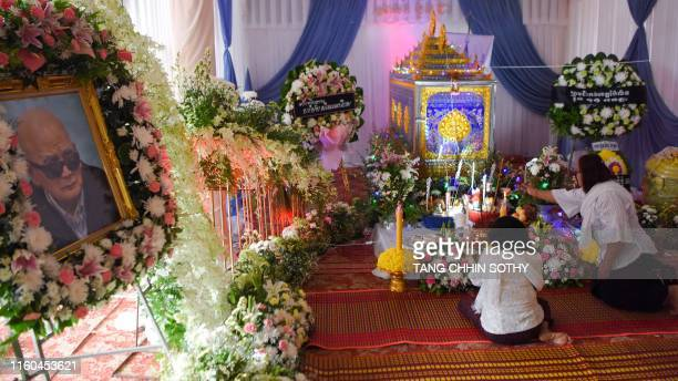 Cambodian women pray before the coffin bearing the remains of Khmer Rouge 'brother number two' Nuon Chea during funeral rites at a Buddhist temple in...