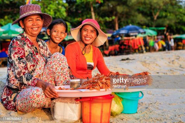 cambodian women selling fresh lobsters on the beach, sihanoukville, cambodia - cambodia stock pictures, royalty-free photos & images