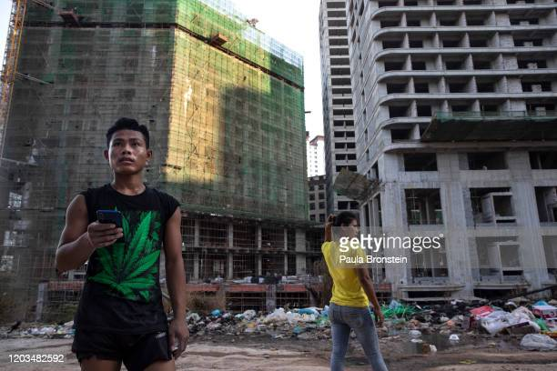 Cambodian workers and their family live in poverty surrounded by the massive Chinese construction going on in Sihanoukville, Cambodia on February 16,...