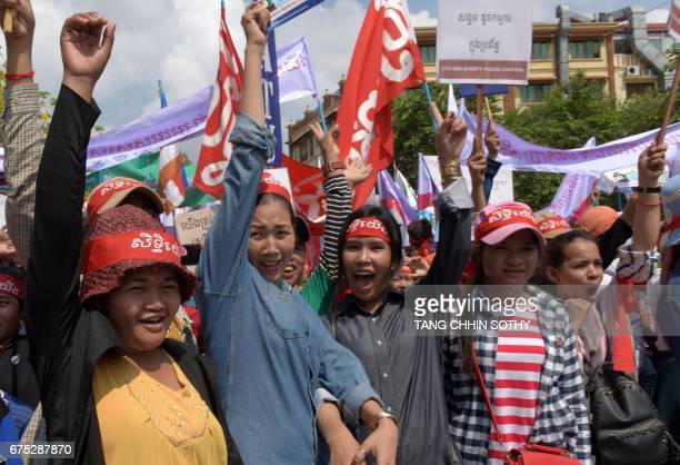 Cambodian workers hold placards and banners as they shout slogans during a May Day or International Workers' Day in Phnom Penh on May 1 2017...