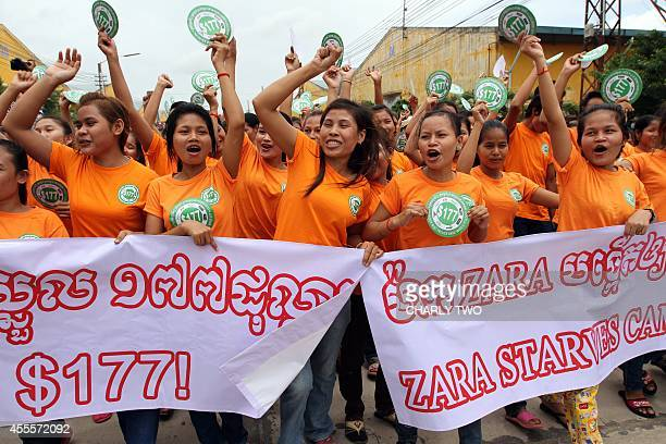 Cambodian workers shout slogans during a launch of campaign to demand higher wages at a garment factory industrial park in Phnom Penh on September...