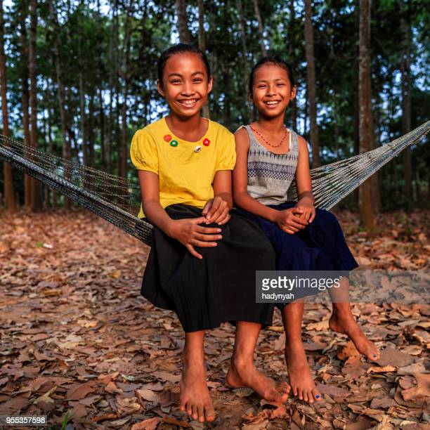 cambodian young girls sitting on hammock near siem reap, cambodia - cambodia stock pictures, royalty-free photos & images
