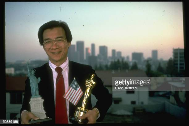 Cambodianborn Dr Haing S Ngor who fled Khmer Rouge regime emigrated to US holding small statue of liberty Oscar Award he won for role in film The...