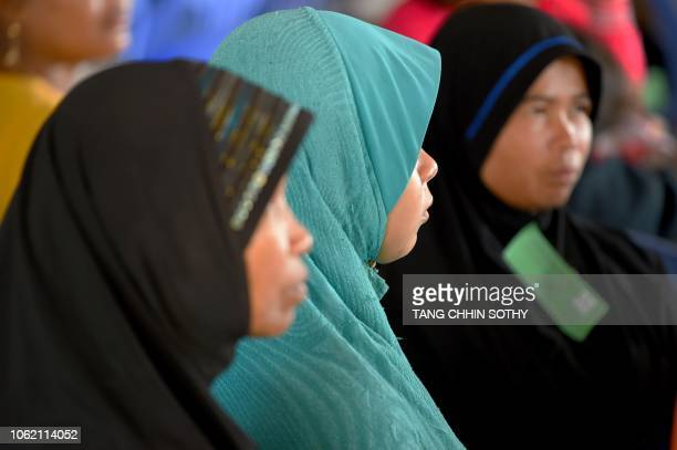 CambodianMuslim women attend the verdict of two former Khmer Rouge leaders at the Extraordinary Chambers in the Courts of Cambodia in Phnom Penh on...