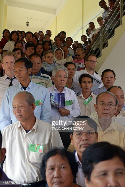Cambodians walk down from the courtroom after watching the verdict in the trial of two former Khmer Rouge leaders at the Extraordinary Chamber in the...