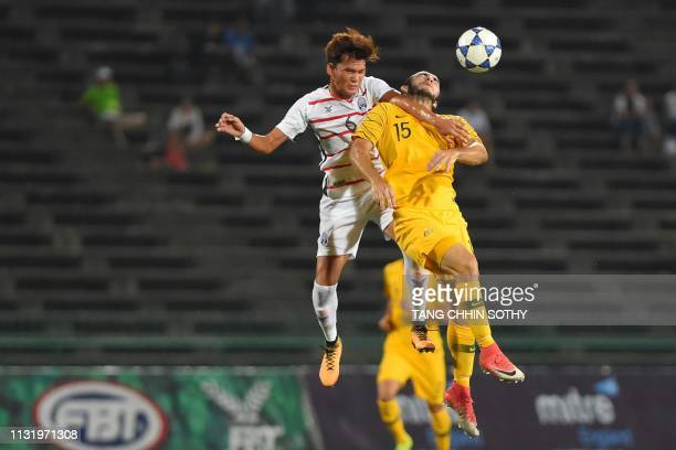 Cambodia's Chhong Bunnath fights for the ball with Australia's Nicholas D'Agostino during the Tokyo 2020 Olympic Games men's Asian qualifier football...