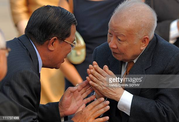 Cambodia's former king Norodom Sihanouk greets Cambodian Prime Minister Hun Sen upon the former king's arrival at Phnom Penh international airport on...