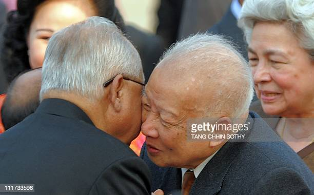 Cambodia's former king Norodom Sihanouk kisses President of Senate Chea Sim as former queen Norodom Monineath Sihanouk smiles upon they arrival at...