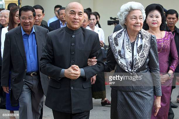 Cambodia's King Norodom Sihamoni and his mother former queen Monique walk as Cambodia's Prime Minister Hun Sen and his wife Bun Rany accompany them...